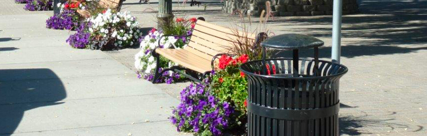 City benches with flower baskets